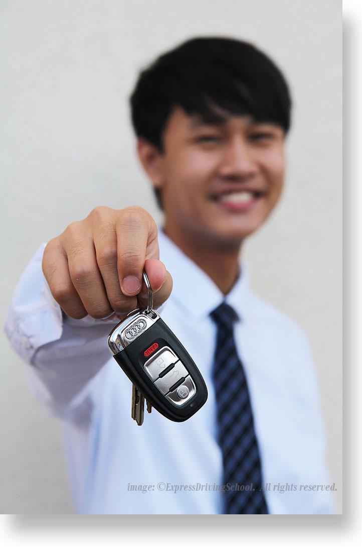 teen holding keys